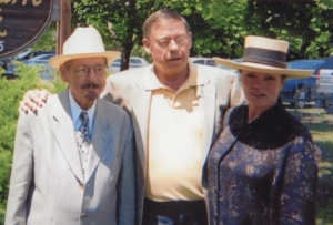 Wilcox, with wife, Fern, and Wilbur Mull
